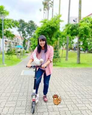Kick scooting with pet chicken
